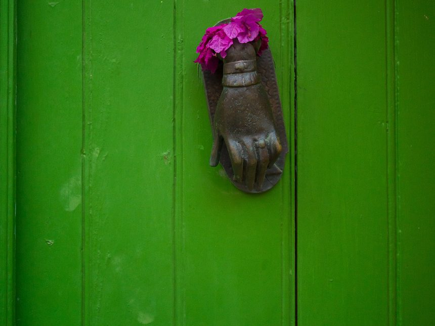 Green door with flower