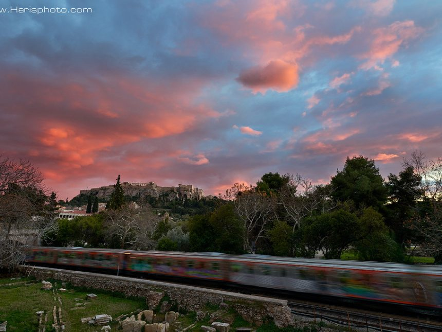 Red sunset at Monastiraki and in the background Acropoli
